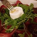 Thin slices bresaola with goat cheese and dried tomatoes