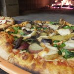 Wood fired pizza on weekends featuring Alaska Grown ingredients.