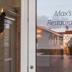 Max's Restaurant and Northern Light Inn entrance. ( Map of Iceland in black).