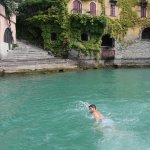 swimming in turqouise waters at nesso waterfall