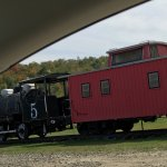 Groveton Covered Bridge and an engine/caboose right next to it. Small and in need of paint but a