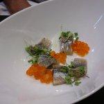 starter - garlic and almonds cream with smoked sardine and salmon caviar before cream added