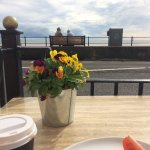 With a lovely food & coffee and watching the world go by the sea side 😃