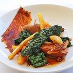 Roasted duck breast, crispy kale, mushrooms, dates and apples.