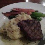 Flat iron steak with garlic mashed potatoes carrots and broccoli