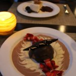 Chocolate mousse (foreground) and cheesecake (background)