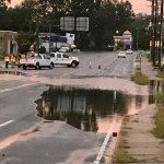 Roadway flooding blocking street outside of Super 8 Suffolk Tidewater