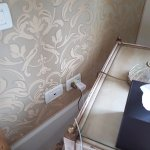 Move bedside table to access wall socket