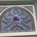 Stain glass in his home.
