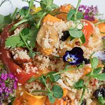 Autumn pear couscous salad with roasted butternut, croutons, and Brazil nuts