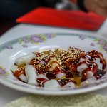 Freshly steamed rice rolls, covered in sesame, hoisin, and chile sauce