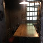 Eat in a jail cell.