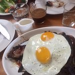 44 ounce weight rib steak, spiced, served with a green salad and eggs
