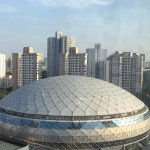 View from my room on 13 floor. Big dome is the shanghai gymnastic center.