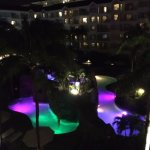 View of pools at night from balcony of room 5437