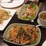 Clockwise - Som Tam salad, Tom Yam Kung, chicken with basil & Pad Thai