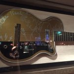 Chris Isaak had decorated his Silvertone guitar with a self-portrait