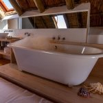 The bath tub is in the loft of Cottage 1, 2 + 3