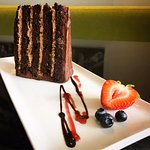 Five High Cake: Five-tiered chocolate cake with chocolate ganache and raspberry coulis