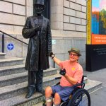 My husband and Abraham Lincoln on the front steps of the New York Historical Society
