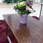Reception area, flowers in a vase on a coffee table