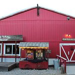 A red barn serves as the dining hall on the Blazin' M.