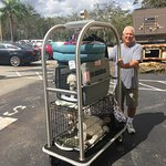 Husband as bellhop leaving hotel with use of hotel pushcart....generator in the background.