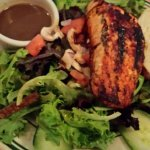 High quality grilled salmon on a salad.