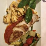 Grilled chicken with tomato noodles and mediterranean vegetables