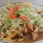 Smothered burger with green chile