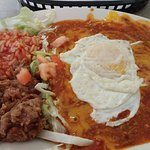 Red chile enchilada with egg