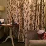 Lovely drapes and two armchairs in room
