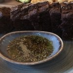 very tasty dark bread with herbs in oil