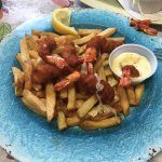 Breaded prawns and chips