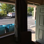 Smelly trash bins in front of our Room, #128 at the Best Western Plus, Redding, CA. The rolling