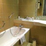 Spacious bathroom with shower and bathtub