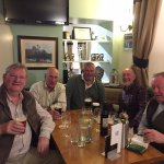 Telling tall fishing stories in the bar in The Boatside Inn.