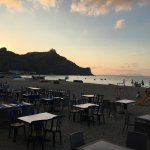Restaurant area on the sand at sunset