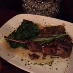 Veal chop with grilled spinach