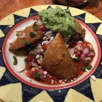 Tasty empanadas with optional guac are deep fried, not baked.
