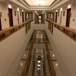 Long corridors with many hotel rooms on different levels