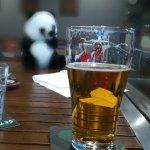 Schooner of beer in the dining area.