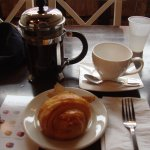 Ham croissant with a french press