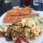 Fried flounder with sautéed vegetables & rice pilaf