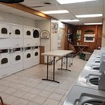 Laundry room. Clean with tv and close to sites.