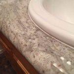 Break in the granite counter and repair looks bad.