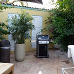 A convenient gas griller near the pool