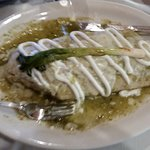 Wet burrito with green sauce