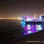 Check the vibrant colours during night time at Corniche Promenade
