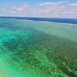 Amazing reef and colour, please stay all day here or more.  Also recommend sandy bay!